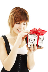 Happy teenage girl with gift box over white background