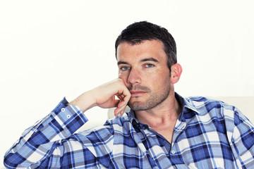 pensive man with blue shirt