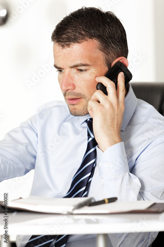 a businessman on the phone in office