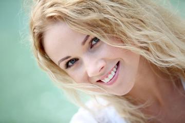 Portrait of beautiful blond smiling woman