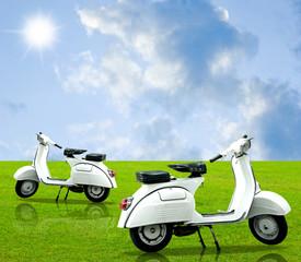 Vintage motorbike on grass with nice sky