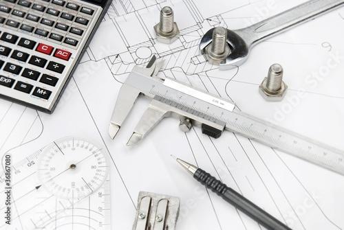 Leinwandbild Motiv technical drawing and calculator