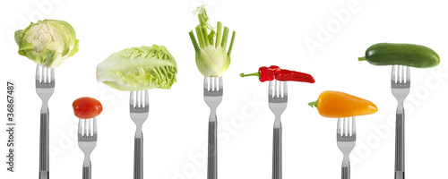 fresh baby vegetables on forks