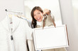 Shopping woman showing blank bag
