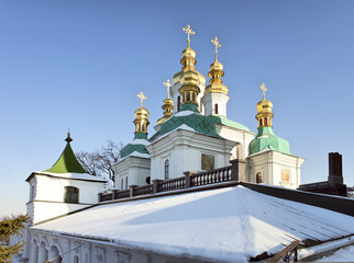 Church cupolas in snow at Kiev Pechersk Lavra Orthodox monastery