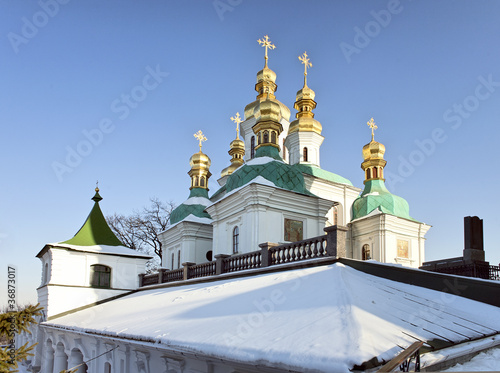 Church cupolas in snow at Kiev Pechersk Lavra Orthodox monastery