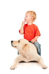 boy sitting on a dog