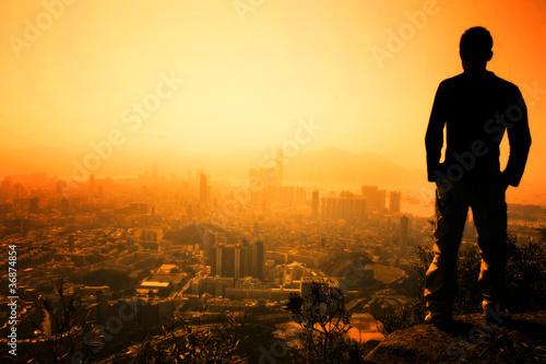 Man standing on the edge of Hong Kong's Lion Peak