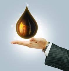 Oil Drop on businessman hend