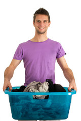 Young man doing the washing