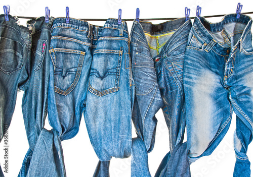 Some blue jeans drying on washing line