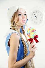Pretty snow maiden holding bright lollipop looking away