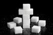 Kreuz aus Zuckerwürfeln