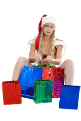 christmas girl with a lot of bright gift packets, isolated