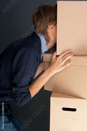 Portrait of anonymous young man with his head inside box Poster