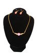 beautiful gold necklace with gem and earrings