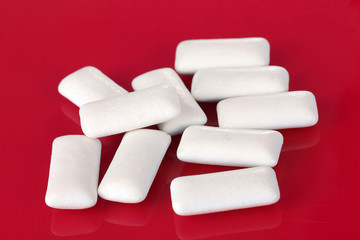 Chewing gums on red background