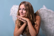 Christmas: Smiling angel with sky-blue background