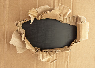 Breakthrough cardboard hole.