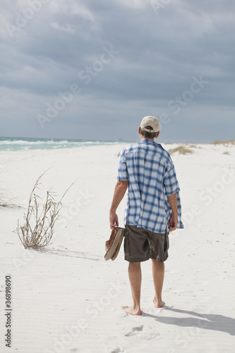 Man Walking on a Beautiful Beach