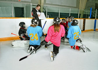 Hockey Coach with Players at Practice