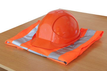 yellow high visibility vest and protective helmet