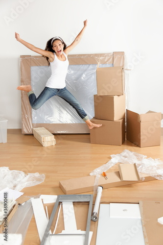 New home - moving woman excited