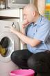 Man loading the washing machine