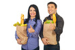 Successful family holding bags with food