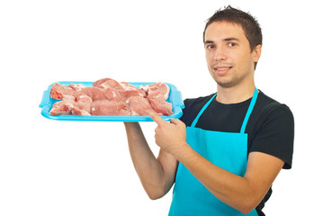 Butcher showing fresh meat