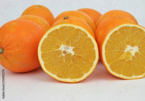 Fotobehang Plakjes fruit Orangen