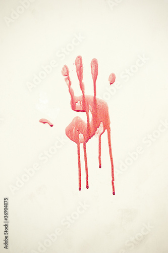Bloody handprint on a wall during muslim festival of Eid