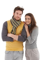 Trendy couple hugging smiling
