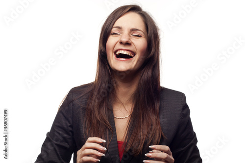 Happy businesswoman laughing aloud