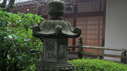 Stone Lantern and Pavilion Veranda in Garden One Foggy Morning