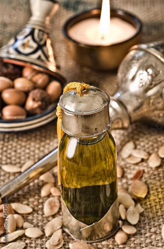 Still life of argan oil with fruits