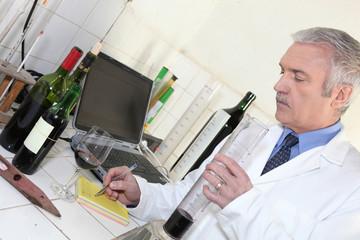 Oenologist testing a wine