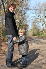 Father and son taking a walk in the woods