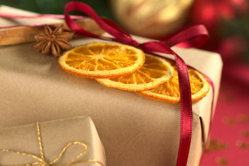 Christmas presents decorated with dried orange slice