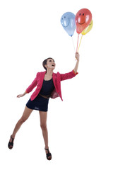 Happy Businesswoman with smiley face balloons