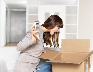 Young Woman opening parcel