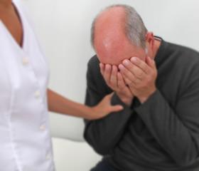 Therapist comforting distressed patient - soft blur