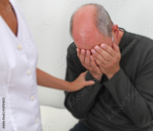 Therapist comforting distressed patient - soft blur