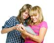 Teenage girls using tablet PC