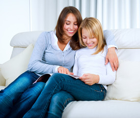 Mother with Teenage Daughter reading Magazine
