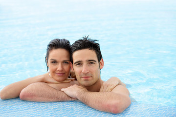 Portrait of a couple at a poolside