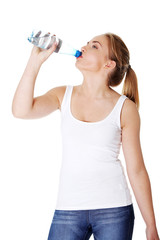 Teen drinking mineral water from bottle