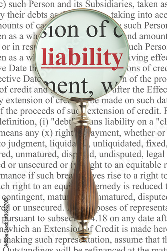 Magnifying glass and word Liability