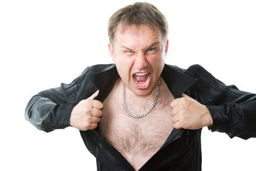 crazy evil man rips his shirt on his hairy chest