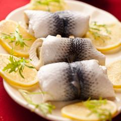 Pickled herring fillets with lemons for christmas